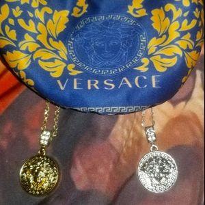 Gold Versace's Medusa head
